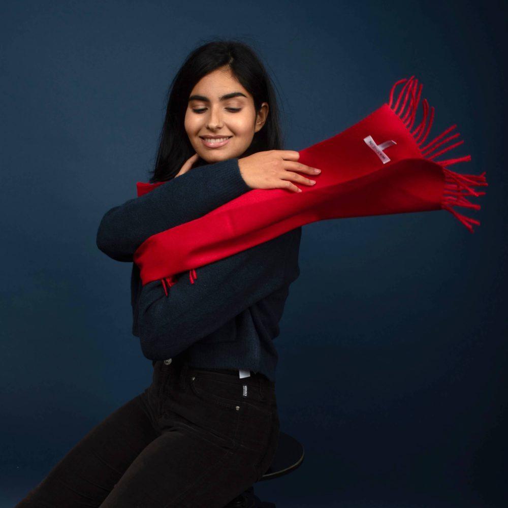 model styling a red alpaca wool scarf