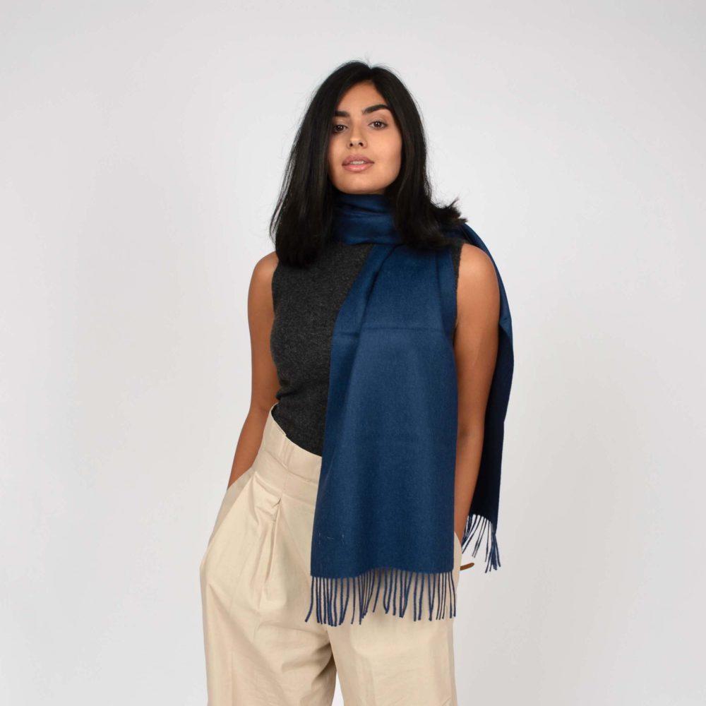 model styling a navy blue alpaca wool scarf